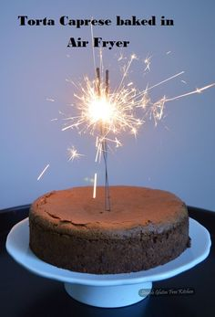 Refined chocolate cake with a thin hard shell covering a moist interior.