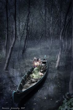 In a boat, alone, in a swamp... hmmm....