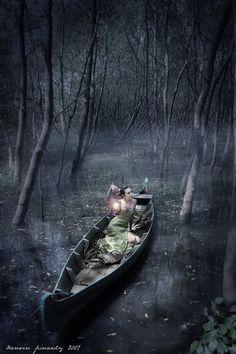 In a boat, alone, in a swamp... hmmm....