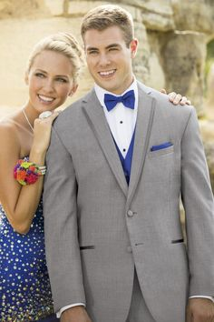 For a polished look, the Heather Grey Aspen tuxedo is a stylish choice. Tailored in worsted wool with a slim fit styling, the Heather Grey Aspen's. Grey Suit Prom, Blue Prom Tux, Tuxes For Prom, Prom Suit, Royal Blue Tux, Aspen, Tuxedo Styles, Grey Tuxedo, Formal Tuxedo