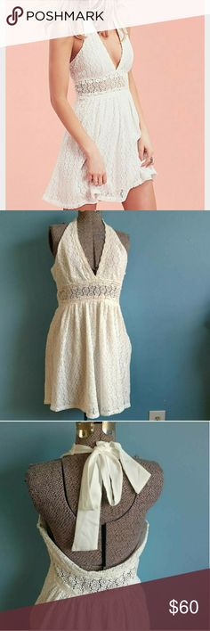 "Free People So Sweetly Dress New without tags Free People ""So Sweetly"" dress. True white, floral crochet mini dress in a halter silhouette with a plunging neckline and a sheer panel in the middle. Lined. Size 10. Shown on a small- will fit an 8 better IMO. Zips up the side. Originally retailed $168. Free People Dresses"