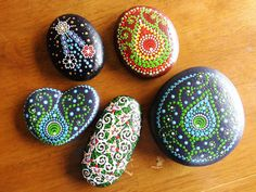 Dot painted stone flowers by ArtAndBeing on Etsy