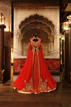 Ashima Leena. Red and gold anarkali