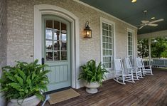 I really like the sage-colored door here. I goes with the tan siding well (this could work with the Cambridge house).