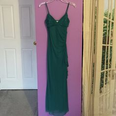 Green jeweled prom gown Prom gown spaghetti straps v neck rouched top covered in sparkly rinestones. Taboo Dresses Prom