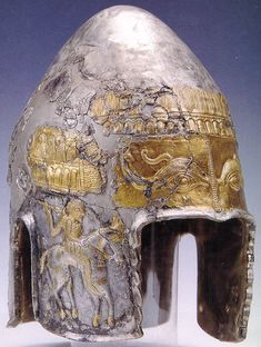 Hagighigoi Helmet  (ca. 4th century BCE) silver gilded. Found in 1931 a tomb of the Dacian prince Cotys, located in the Romanian region of Dobruja. In the outer chamber were found the skeletons of horses, with the hammered silver plaques of their rich harness. The inner chamber contained the entire silver treasure of the prince himself -- Muzeul National de Istorie a Romaniei, Bucuresti