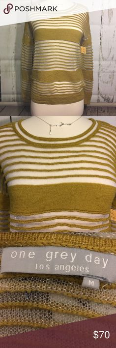 🎀One Grey Day Knit and Sheet Striped Sweater🎀 Gorgeous mustard colored knit combined with sheer sparkling silver stripes. Such a unique piece, would look great with anything from jeans to a black leather slim fit skirt or pants! One Grey Day Sweaters