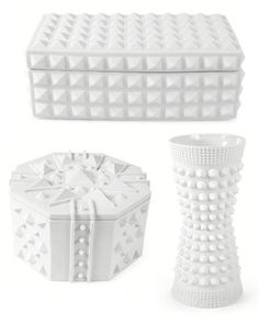Jonathan Adler Charade collection.  Could  possibly DIY this look with metal studs and wooden bases + lots of matte white paint!