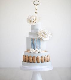 Peonies coupled with abstract hand-painting make this wedding cake almost too beautiful to eat.