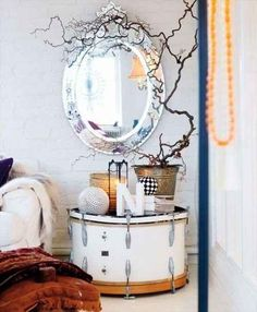 Use a drum for a bedside table.