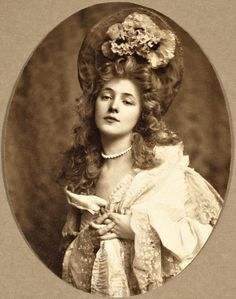 """Evelyn Nesbit in costume by Rudolf Eickemeyer. Model, actress-as Marie Antoinette. (December 25, 1884 – January 17, 1967) Florence Evelyn Nesbit, an American chorus girl and artists' model whose liaison with architect Stanford White immortalized her as """"The Girl in the Red Velvet Swing."""""""