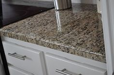 "DIY granite mini slab tiles (with optional edge tiles), about $15 per sqft. They are only 1/2"" thick so these are not appropriate for under mounted sinks in the kitchen (the edges around the sink can chip with such thin granite). These would work in a bathroom, laundry room, or with a top-mounted sink in the kitchen, though."