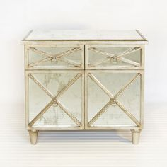 I love the antique look of this cabinet with  mirror and silver leaf finish  #antique #mirror #modern