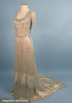 "CRYSTAL BEADED TRAINED EVENING GOWN, c. 1909  1-piece cream silk satin w/ heavily beaded white tulle over-dress, also decorated w/ faux baroque pearls,""Frederick Loeser Brooklyn"""