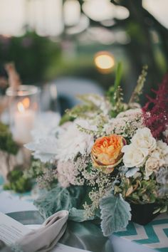 great mix of #flowers, photo by Fondly Forever http://ruffledblog.com/intimate-big-sur-wedding #centerpieces #wedding