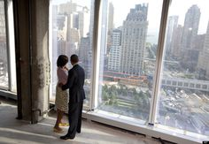 President Barack Obama and First Lady Michelle Obama look out over the 9/11 Memorial as they visit the Port Authority of New York and New Jersey's World Trade Center site for a briefing on construction progress, Thursday, June 14, 2012, in New York.