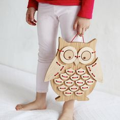 Our newest wooden toy is now available. We are making a small, handmade edition of birds (handmade by our hands... not by a cnc or laser cutter by the way). Put tiny fingers happily to work threading Ollie Bird's feathers and wings onto her body. Thread them in order, upside down or any which way. But please don't forget her spectacles! She is blind as a bat without them. When she is dressed, she looks quite dapper and can hang on the wall to brighten up any lucky kid...
