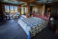 Perched upon the Karbonkelberg Mountain in Hout Bay, the Litchtenstein Castle is something out of a fairytale – with a guarding dragon statue, a tower and a ballroom fit for royalty. Lichtenstein Castle, Bed Frame Design, Honeymoon Suite, Elegant Chandeliers, Black And White Theme, Banquet Tables, Arched Windows, Dark Wood, Family Room