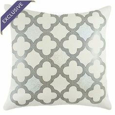 """Handmade in the USA, this chic cotton pillow showcases a sequined quatrefoil motif for shimmering style.    Product: PillowConstruction Material: Cotton and sequinsColor: Silver, black and whiteFeatures:       Handmade by TheWatsonShop  Insert included with zipper enclosure  Made in the USA Dimensions: 16"""" x 16"""" Cleaning and Care: Spot clean"""