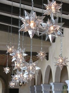 love the different sizes and the light and glass mixed with the dark wood beams in the background moravian star pendents grouped at la hacienda san angel - Star Pendant Light
