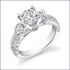 18kt white gold diamond engagement ring semi mount with one round diamond on each side of center and channel set princess cut diamonds with hand engraving with