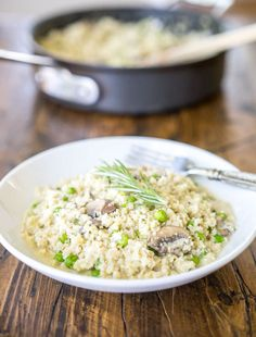 """Creamy #vegan mushroom & rosemary risotto with a twist... it's made from cauliflower """"rice"""" instead of starchy arborio rice."""