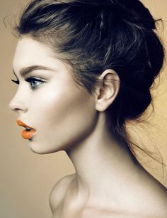 Neon lips and messy up do.