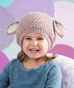 Knit this fun bobbled hat with ears and your little lamb will look picture-perfect!