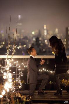 A rooftop proposal with a view one can't refuse.