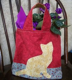 Hey, I found this really awesome Etsy listing at https://www.etsy.com/listing/42842819/kitty-cat-tote-bag-with-yellow-applique