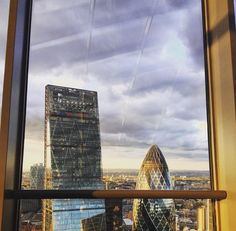 Up high! Reflections, The Wedge and The Gherkin London.
