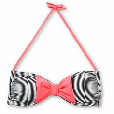 The Damsel Coral Bow Mini Stripe bandeau bikini top is the perfect blend classic style with a girlie twist. The Black and White mini stripes of this Damsel bandeau top is accented by a large Neon Coral bow at the front, while the single back and neck tie