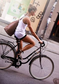 go green girl on bicycle