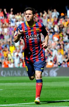 Lionel Messi of FC Barcelona celebrates after scoring the opening goal during the La Liga match between FC Barcelona and Getafe CF at Nou Camp on May 3, 2014 in Barcelona, Catalonia.