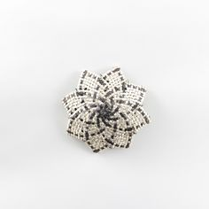 Iwi Art Store - Woven copper and silver whetu brooch (MMW258), $790.00 (http://www.iwiart.co.nz/woven-copper-and-silver-whetu-brooch-mmw258/)