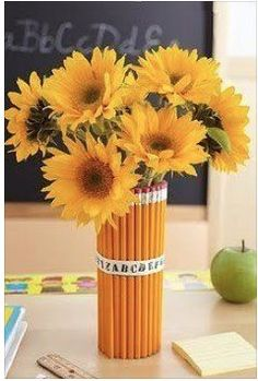 Cute classroom decoration or teacher gift! You could use plastic flowers and attach them to pens.