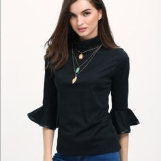 FLASH SALE Black Peplum Sleeve Top Black high neck top. Peplum sleeves are lined with faux leather! Fits true to size!Model is wearing a small. ✨✨ SAME DAY SHIPPING!!! Tops