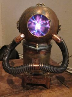 How clever! Recycled divers helmet and plasma ball wow!