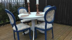Elegant shabby chic round oak table with 4 dining chairs.   The chairs have been painted Annie Sloan Napoleonic Blue.  The Chairs have been re- upholstered in very rare Laura Ashley fabric .      The table has been painted Annie Sloan Old White.     (professionally sprayed).