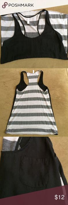 Razorback Tank Black front razorback tank with cotton grey and black striped backing. In good condition, no stains, rips or tears. Has front pocket. Xhilaration Tops Tank Tops
