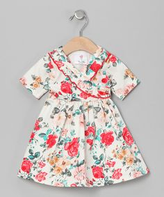 This low-maintenance dress is equally fashionable and functional. Soft cotton and a stretchy surplice bodice make it easy to put on, while ruffles and a darling print give it a bit of fancy flair. 100% cottonMachine wash; tumble dryMade in the USA