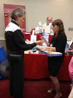 Temple greeted readers and autographed their books at the Special Needs Project booth in Phoenix in September, 2014