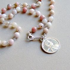 This pink opal item can be worn as a bracelet or a necklace.  Opal and Tourmaline are the birthstones for October.