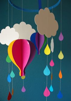 "Haven't done this yet, but intend to this week! I plan on making white, grey, and black clouds, too, in honor of Pooh's ""little black rain cloud,"" and lots of colored raindrops. (Mom's Crafty Space: Up, Up & Away! Detailed tutorial linked at http://www.sacramentoparent.com/magazines/sacramento-parent/2012/march-issue/941-up-up-and-away)"