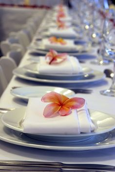 flowers on every napkin - simple wedding favor/decoration in addition to the fans