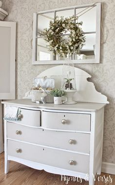 Love the Daisy Wreath hung over the mirror via Hymns and Verses: Spring Cottage Style Buffet