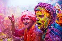 Tourists and locals celebrate Holi together. Photo by Jitendra Singh Flickr