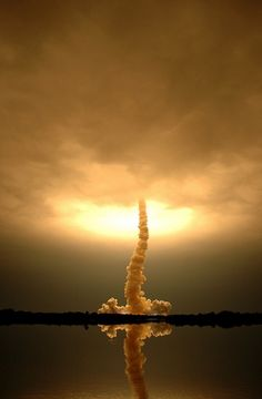 tail of smoke chases the space shuttle Endeavour as it lifts off from Cape Canaveral, Florida, on March 11, 2008