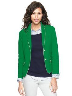 Green blazer, navy top, khaki pants.