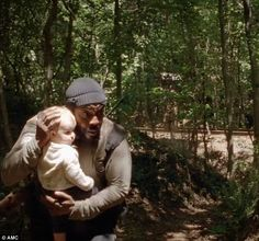 Precious cargo: The cherubic child is actually the daughter of the hit show's mentally-unstable leader Rick Grimes (Andrew Lincoln), who has...